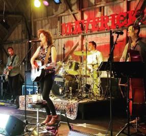 Joe Wilkins, Alex Bridge & Paul Reynolds on stage with Amy McCarley at Maverick Festival 2018 © Amy McCarley