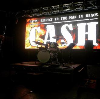 CASH (paying respect to the man in black) ©Alex Bridge